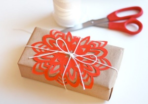 cutting-paper-snowflakes